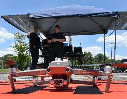 Operators prepare to launch the two Harford County Sheriff's Office small Unmanned Aircraft Systems Unit (sUAS) during a demonstration Wednesday, June 16 2021 at the Sheriff's Office Southern Precinct.
