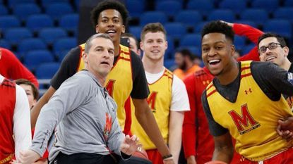 Maryland head coach Mark Turgeon, center, reacts as he attempts a half-court shot during practice at the NCAA college basketball tournament in March.
