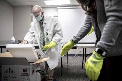 Doses of Covid-19 vaccine arrive at a hospital in Pine Bluff, Ark., Dec. 15, 2020. A more contagious variant of the coronavirus may alter the course of the pandemic in the United States, researchers said.