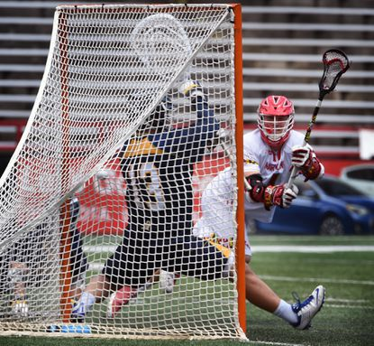 Maryland's Matt Rambo, right, scores on Quinnipiac goalie Jack Brust in the third quarter. Maryland defeated the Quinnipiac Bobcats, 13-6, on May 15, 2016 in the NCAA men's lacrosse tournament.