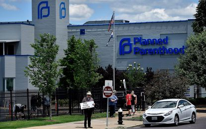 At the Planned Parenthood clinic in St. Louis anti-abortion protesters stand in front of the clinic on May 30, 2019. Such protesters often refer to themselves as 'pro-life' but a broader interpretation of that term suggests they do not fit the definition.