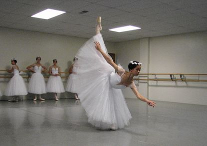 """Genevieve Ferris, a graduating senior at Mt. Hebron High School, performs as the icy queen Myrtha in the production of """"Giselle"""" at the jim Rouse Theatre."""
