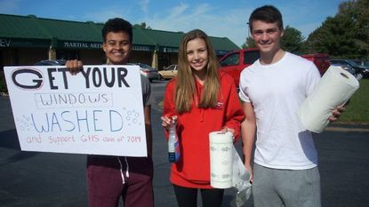 Glenelg High School Student Government Association members from left to right, Abraham LeFevre, president, Anna Lawson and Devon Henley prep for making car windows squeaky clean.