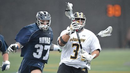 Alex Woodall, right, a junior faceoff specialist for the Towson men's lacrosse team, was named the Colonial Athletic Association's Co-Player of the Week after winning a career-high 22 faceoffs in Saturday's 13-7 win over Delaware.