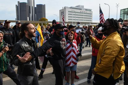 Supporters of President Donald Trump, left, attending a rally to stop the ballot counting, argue with a person outside the TCF Center in Detroit on Thursday, Nov. 5, 2020. Attention shifted on Thursday to a handful of states where the presidential result remained too close to call.