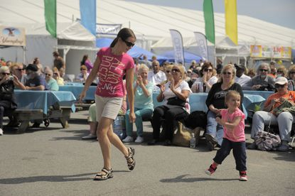Liza Sokolova dances with Corra Powers, 2-1/2 of Baltimore, at Springfest.