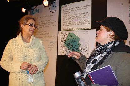 Ada Ghuman, left, a local painter and member of the Laurel Art Guild, chats with Melissa Burley, a resident artist at the Montpelier Arts Center, during a meeting hosted by the Laurel Arts District Exploratory Committee on Thursday, Feb. 16 at Venus Theatre on C Street.