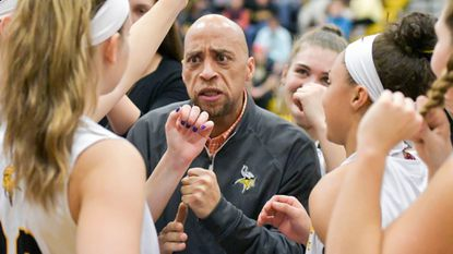 Mt. Hebron coach Anthony Bell, seen encouraging his team earlier this season, helped guide the Vikings to their second straight win on Feb. 3 against Centennial.