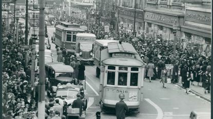 Streetcars, automobiles and pedestrians line the streets of North Howard Street in Baltimore in January 1941.