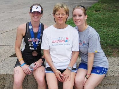 Erika Brannock sits next to her mother, Carol Downing, and her sister, Nicole Gross. Graul's market in Hereford held a fundraiser on Saturday for Brannock, who was severely injured in the Boston Marathon bombing.