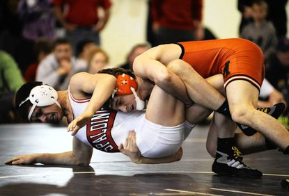 McDonogh junior Jack Clark, top, recorded a 22-7 technical fall over Archbishop Spalding's Cole Graves to win his third straight MIAA championship Saturday afternoon.