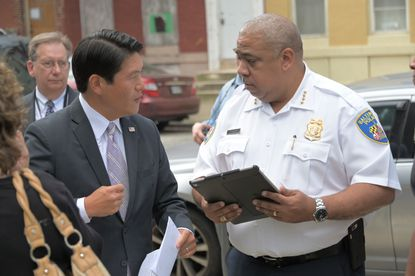 U.S. Attorney Robert K. Hur, left, announced that 89 accused gang members and drug traffickers in Baltimore have been indicted over the past month. The efforts are designed to ease the city's crippling violence and help Baltimore Police Commissioner Michael Harrison, right, in his efforts to get crime under control.