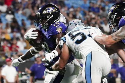 Baltimore Ravens running back Nate McCrary scores against the Carolina Panthers during the second half of a preseason NFL football game Saturday, Aug. 21, 2021, in Charlotte, N.C. (AP Photo/Jacob Kupferman)