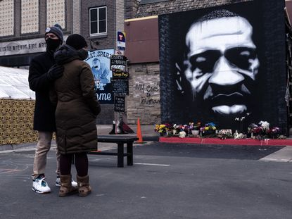 People visit the makeshift memorial on Saturday, April 10, 2021, to George Floyd outside Cup Foods where he died in Minneapolis.