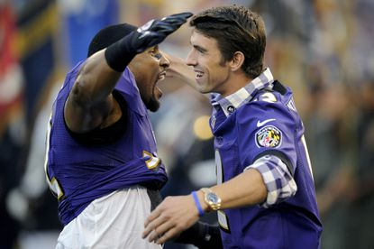 Then-Ravens linebacker Ray Lewis, left, and Olympic swimmer Michael Phelps hug before an NFL football game against the Cincinnati Bengals in Baltimore, Monday, Sept. 10, 2012.