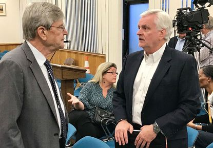 Randy Nungester, right, general manager for Armstrong Utilities, speaks with Harford County Council Attorney Charles Kearney following a June 4, 2019, public hearing on a council bill establishing a 15-year cable franchise agreement for Armstrong. Armstrong recently backed out of a deal with county government to apply for a federal grant to help fund broadband internet expansion in northern Harford County. The county is now searching for a new Internet Service Provider to work with in applying for the grant.