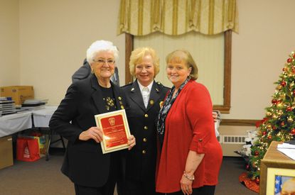Chris Cornes, left, is recognized as Joppa-Magnolia's top ladies auxiliary responder by Margaret Bullock, center, and Bonnie Haden.