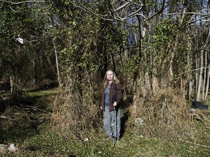 Crime blogger Ellen Worthing near the spot where four young boys were found dead in Leakin Park