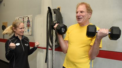 Elizabeth Harris, left, a personal trainer at the Columbia Gym, works with her client Steve Yahr, 72, of Highland.