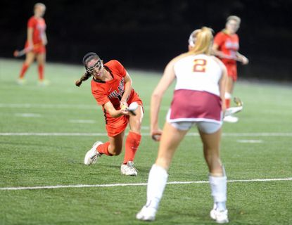 Dulaney's Reece Spann, left, was one of six Lions to score in her team's 7-1 rout of visiting Perry Hall Thursday in a Class 4A second-round playoff game.