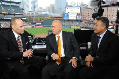Ernie Johnson, Cal Ripken Jr. and Ron Darling (left to right) are seen in the TBS broadcast booth at Oriole Park at Camden Yards prior to Game 2 of the ALCS playoff series against the Kansas City Royals.