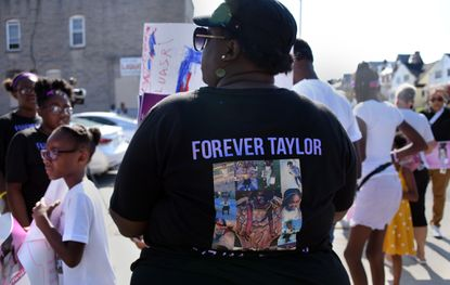 Angel Gray, an aunt of Taylor Hayes, attends a peace walk last summer in the Edmondson Village neighborhood with dozens of relatives and friends of the family of the 7 year old. Keon Gray was convicted of shooting the girl and faces sentencing on Friday.