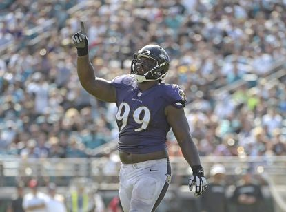 Baltimore Ravens defensive end Timmy Jernigan (99) celebrates a big play against the Jacksonville Jaguars during the second half of an NFL football game in Jacksonville, Fla., Sunday, Sept. 25, 2016. (AP Photo/Phelan M. Ebenhack)