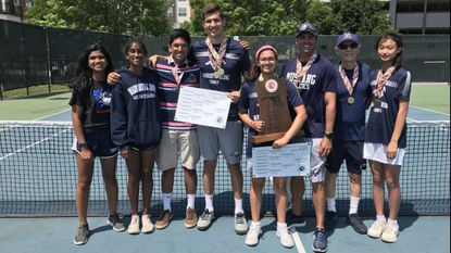 Marriotts Ridge players and coaches pose with the MPSSAA Class 2A state championship trophy at the Wilde Lake Tennis Club in Columbia on Saturday, May 25, 2019.