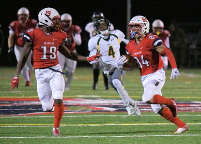 Franklin wide receiver Corey Crawford (19) joins Alex Jones (84), who sprints ahead of Dundalk Eagles defensive back Koby Anthony (4), scoring a touchdown during the 2019 MPSSAA Class 3A playoffs Fri., Nov. 15, 2019. (Karl Merton Ferron/Baltimore Sun Staff)