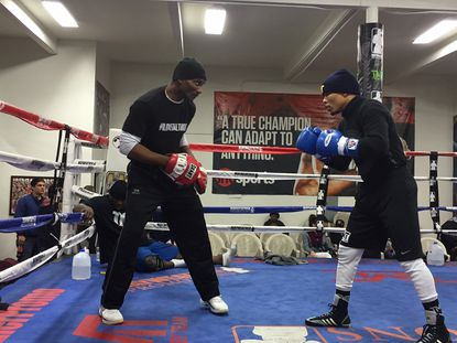 """Gervonta """"Tank"""" Davis, right, works out with Calvin Ford, his longtime trainer, in preparation for his fight tonight."""