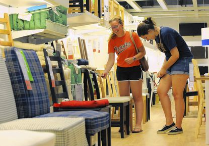 Ally Dickstein, 18 and Libby Greis,19 are shopping for furniture for the apartment they are sharing at Towson University.