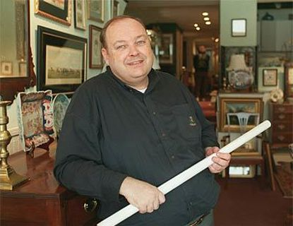 Philip S. Dubey is pictured in February at the opening of his Antiques Row Stalls on Howard Street.