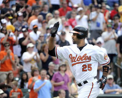The Orioles' Derrek Lee comes home after his three-run homer in the fourth inning gave his team a 4-0 lead over the Reds at Camden Yards.