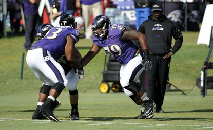 Left to right, Blaine Clausell (63) and Ronnie Stanley (79) participate in Baltimore Ravens training camp Thursday, Aug. 4, 2016.