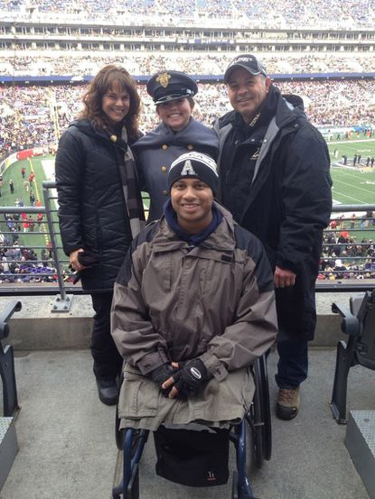 Left to right, Holly, Jim Reed's wife; Heather, his daughter; Jim Reed and in front, Ryan Major. Reed and Major have made a tradition of attending the Army-Navy game.