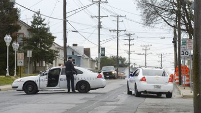 Hampstead police block Main Street at the intersection of Gill Avenue in Hampstead on Friday afternoon.