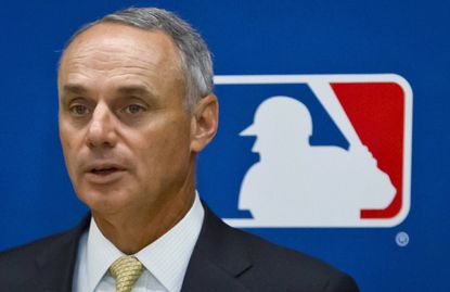 Major League Baseball Commissioner Rob Manfred speaks during a May news conference in New York.