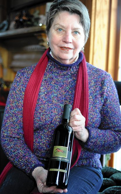 Diane Hale, owner of Galloping Goose, poses with a bottle of the vineyard's new Flirting Heard Cabernet.