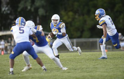 Liberty's Tommy Nelson runs the ball downfield in the first half as the Lions play Walkersville in Eldersburg during Liberty High School's home football opener Friday, Sept. 3, 2021. Friday night fall football returned to Carroll County for the first time since 2019.