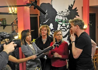 """At the """"Kitchen Nightmares,"""" press conference with Gordon Ramsay, at right, Cafe Hon owner Denise Whiting, third from left, (in eyeglasses) announced that she is relinquishing the """"Hon"""" trademark. Standing next to Whiting are Cafe Hon manager Deborah Harris, second from left, and Lisa Davis, Honfest planner, behind Ramsay."""
