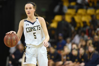 Catonsville senior Gabby Douglas, shown dribbling up the court in the state championship game last season, is in her fourth season on the varsity for the Comets, who open the season on Monday, Dec. 10 at home against St. Paul's.