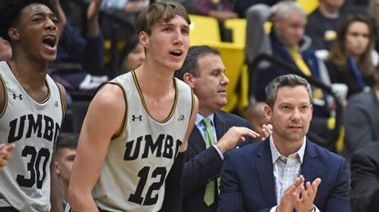 """UMBC coach Ryan Odom, right, and players Daniel Akin, left, and Brandon Horvath cheer against Coppin State last season. """"It's pretty crazy. Little kids and people know who we are,"""" Horvath said after the Retrievers' historic upset. """"I laugh. It's just funny."""""""