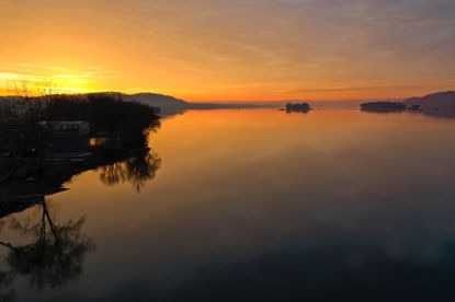 Sunrise lights up the Susquehanna River in Lancaster County, Pennsylvania. Farmers in the region complain that curbing agricultural nutrients and sediment from running into Susquehanna and ultimately the Chesapeake Bay can be costly.