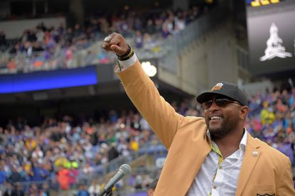 Former Ravens linebacker Ray Lewis punches the sky with his new Hall of Fame ring during a game in September 2018 at M&T Bank Stadium.