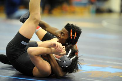 Oakland Mills junior Dakota Thompson, seen here in this file photo, helped lead his team to a 1A/2A South regional wrestling tournament title Feb. 27-28 at Southern (AA) High School.