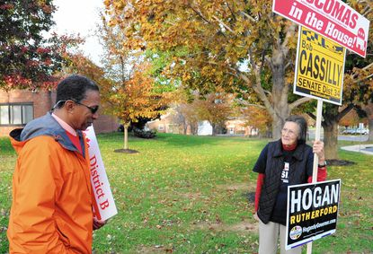 Outside Bel Air Elementary School Tuesday, Offie Clark, a volunteer for House of Delgates candidate Cassandra Beverley, talks with Nancy Cassilly, whose sons Joseph, Robert and Andrew are candidates for state's attorney, state senate and delgate, respectively.