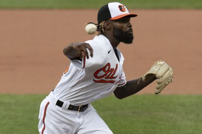 Baltimore Orioles relief pitcher Miguel Castro (50) delivers a pitch during a baseball game against the Boston Red Sox, Sunday, Aug. 23, 2020, in Baltimore. (AP Photo/Tommy Gilligan)