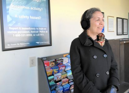 Holiday traveler Kathleen Kearney, of New York City, smiles Wednesday as she talks about her family's Thanksgiving traditions. Kearney traveled by Amtrak from New York to Aberdeen, and she will spend the holiday with family in Bel Air.