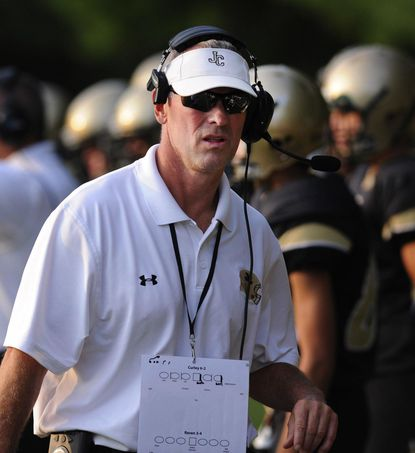 John Carroll varsity football coach Keith Rawlings, shown in 2014, stepped down at the end of the 2017. He led the Patriots in 2008 and 2009 and then from 2017 to this season, compiling a 37-25 record.