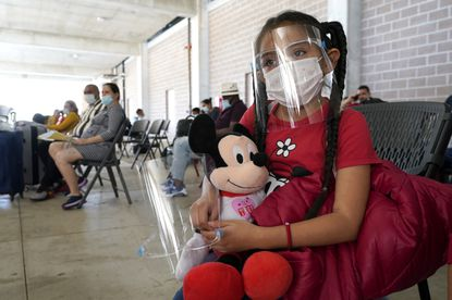 Genesis Cuellar, 8, a migrant child from El Salvador, sits in a waiting area to be processed by Team Brownsville, a humanitarian group, helping migrants released from U.S. Customs and Border Protection custody in Brownsville, Texas.
